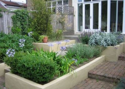 A chic garden in silvers and greens with purple and blue accents   Oakwood