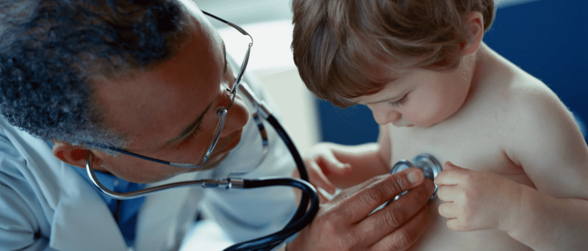 pediatrician with stethoscope and child
