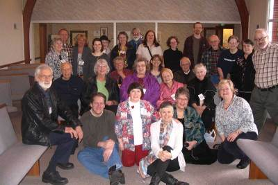 A gathering of folks after worship in 2012