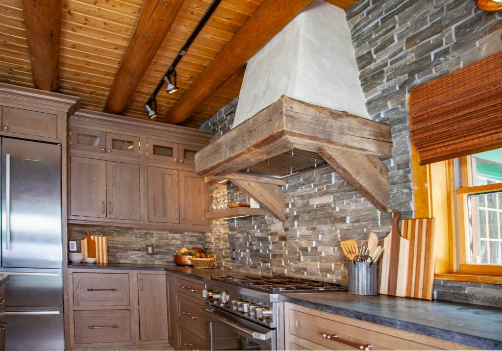 Custom Plaster Hood over ledgestone backsplash and soapstone counters