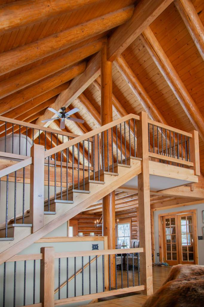 Custom staircase built and designed for this post and beam house.