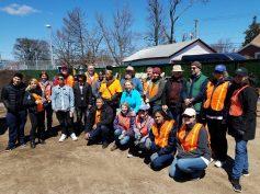 Volunteers help build the Roosevelt Community Garden in 2018