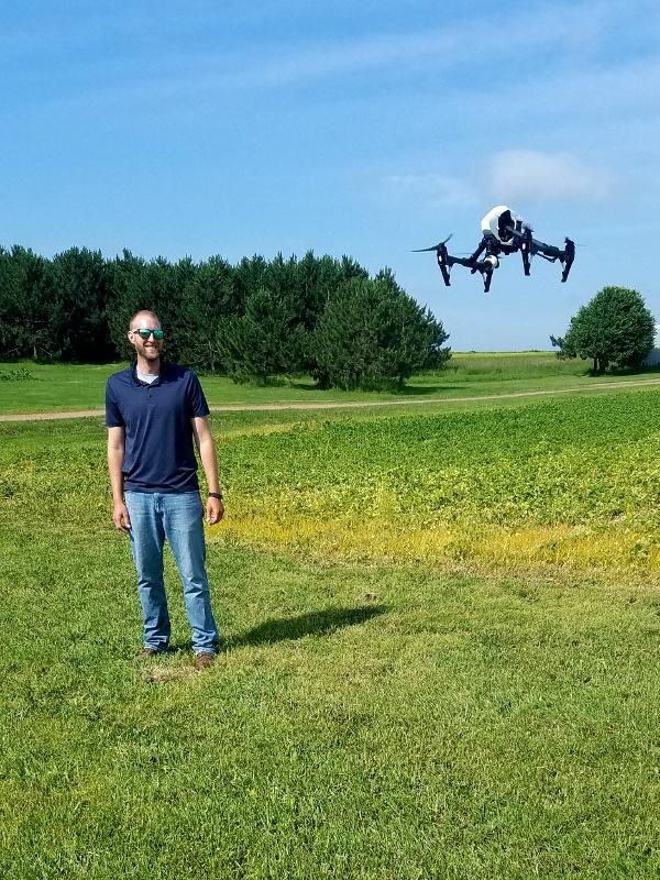 Agronomist Drew Mizgalski and crop scouting drone.