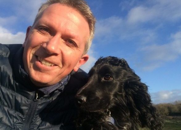 Andy Cleary, owner of Mendip Dog Walking and Pet Services with Raffi