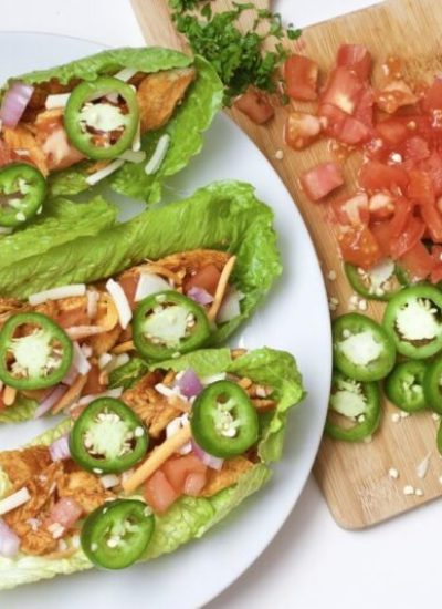 Light, crispy and delicious Buffalo Chicken Lettuce Tacos are made in 20 minutes or less. An easy, gluten-free, low carb, keto and paleo recipe. Enjoy the wraps as an appetizer or main dish. Mexican Recipes | Lettuce Tacos | Chicken Tacos | Spicy | Hot Sauce | Summer Recipe | Game Night | Date Night | Dinner | Low Carb | Ketogenic | Keto | Weight Loss | Buffalo Chicken | Paleo | Easy Dinner | Salad | Romain Lettuce | Lettuce Taco Shells |