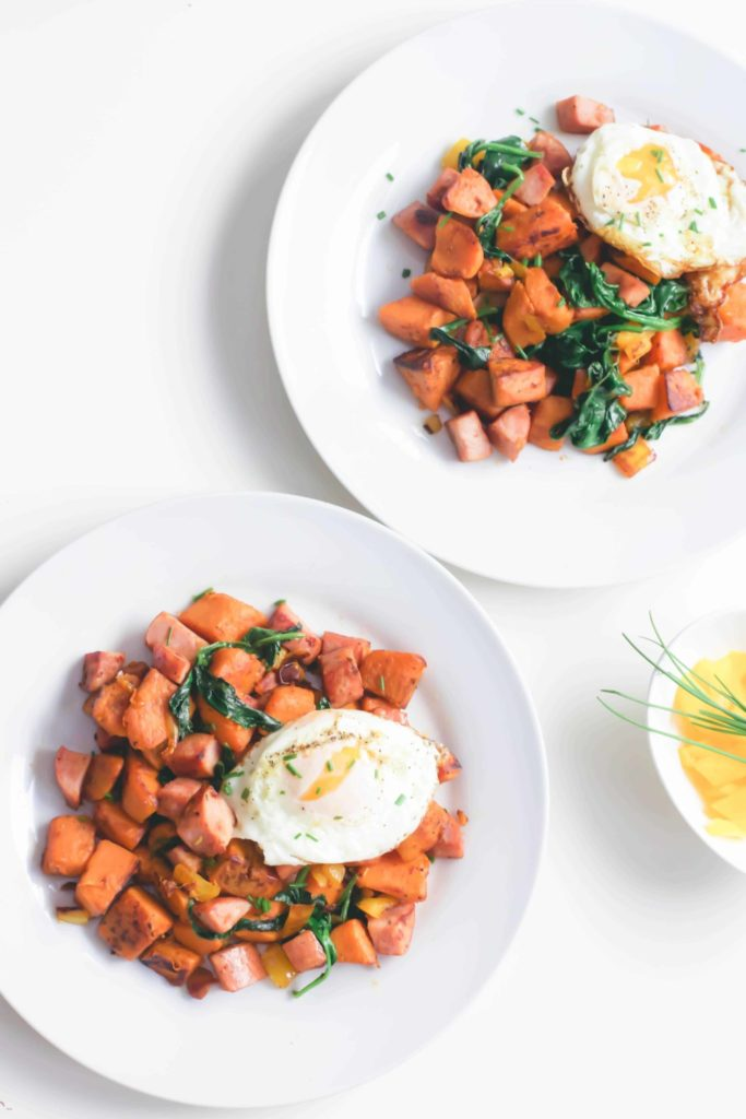This healthy sweet potato and kielbasa skillet is high in protein and fibre, a hearty whole 30 approved breakfast made in only 20 minutes. One pot | Easy | Paleo Breakfast | Paleo Recipes | Whole 30 Recipes | Uncured Meat | Sugar Free | Non GMO | Gluten-Free | Weight Loss | Low Carb | Low Fat | Brunch | Lunch Recipe | Lunch | Organic | Clean Eating | Breakfast Hash | Filling | Fitness | Wholesome | Crispy |
