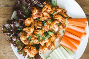 Cauliflower Buffalo Wings are low carb, crispy, and have the perfect amount of hotness. Enjoy at dinner, on game night, or serve them as a tasty appetizer! Vegan Wings | Paleo | Whole 30 | Dinner Recipes | Easy Dinners | Dinner Ideas | Appetizers | Side Dish | Spicy | Mexican | Veggies | Fibre | Low Calorie | Gluten Free | Grain Free | Plant Based | Clean Recipes | Cauliflower Bites | Buffalo Wing | Hot Sauce | Crispy | Oven Baked | Healthy Eating Ideas |