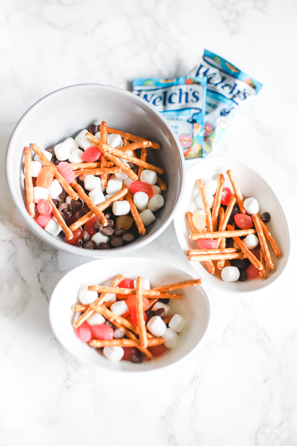 Throw your child's favourite ingredients together to create a snack that's great for summer, travelling, back-to-school lunches and after-school munchies! Lunch Ideas, Lunchbox, Kids Trail Mix, Travelling with Kids, Bonfire, S'mores, Pretzels, Marshmallows, Welch's Fruit Snacks, Fun Food, Road Trip Ideas, Camping with Kids, Glamping, Motherhood, Parenting