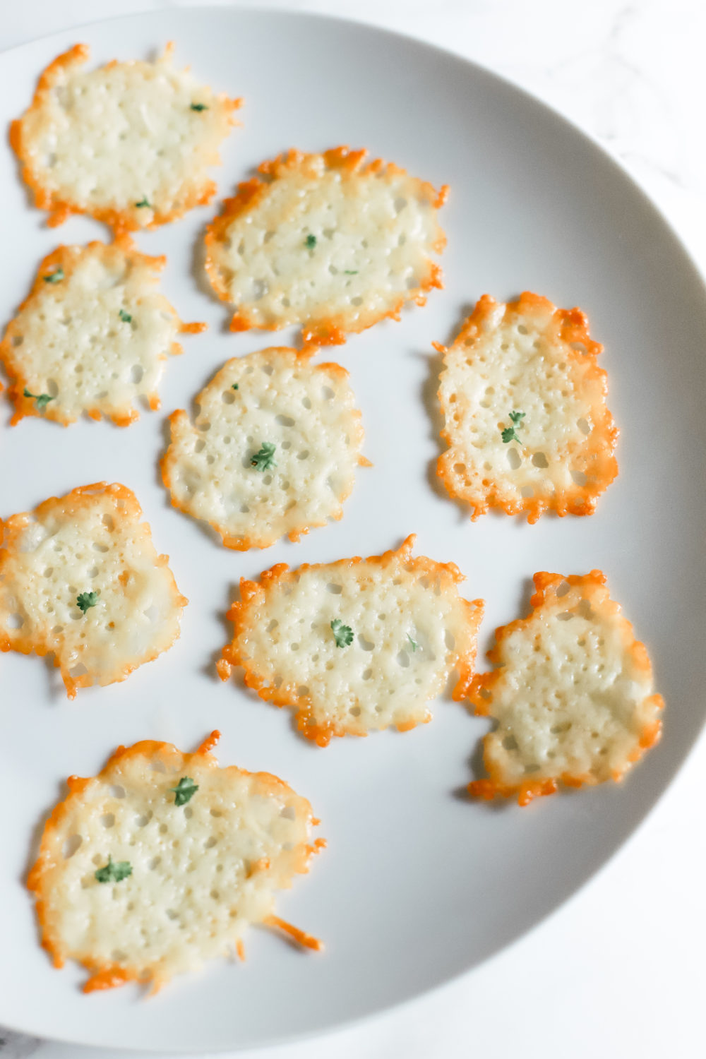These parmesan chips replace your guilty pleasure while keeping you in ketosis. They're gluten free, low carb, and ketogenic friendly - only 5 minutes to make! Parmesan Crips | Keto Chips | Keto snacks | Weight Loss | Atkins Diet | Keto Diet | Easy Low Carb Snacks | Appetizers | Christmas Recipe | Holiday Appetizer | Oven Baked |