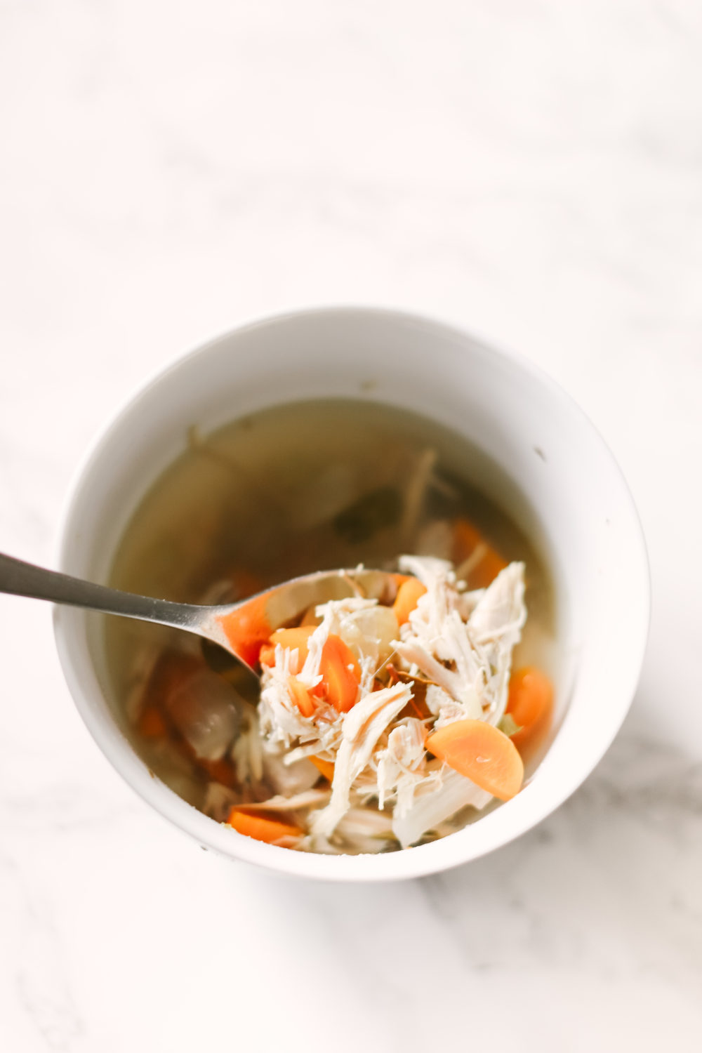 Warm, hearty, and healthy slow cooker turkey soup puts the leftovers to good use! Perfect for after a Thanksgiving or Christmas turkey dinner, a recipe that's gluten-free, keto, paleo, and whole 30 friendly. Low Carb | Soups | Soup Recipes | Slow Cooker Soup | Crock Pot | Healthy Soup | Weight Loss | Fat Burning | Protein | Atkins | Ketogenic | Easy Soup Recipe |