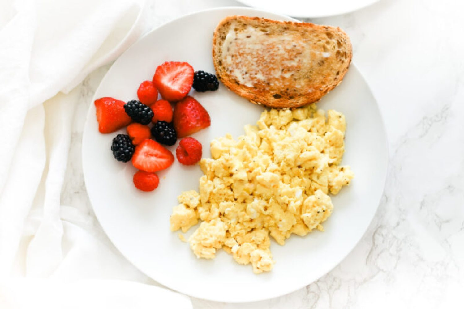 These perfect fluffy scrambled eggs make for a healthy, quick and easy breakfast every time. Naturally low in carbs, keto, and gluten-free.Breakfast | Brunch | Cooked Eggs | Keto Eggs | One Pan Breakfast | Creamy Eggs | Healthy | Weight Loss | How to Scramble Eggs | The Best Scrambled Egg Recipe | Family Friendly Recipe | Traditional Eggs | Egg Recipes |