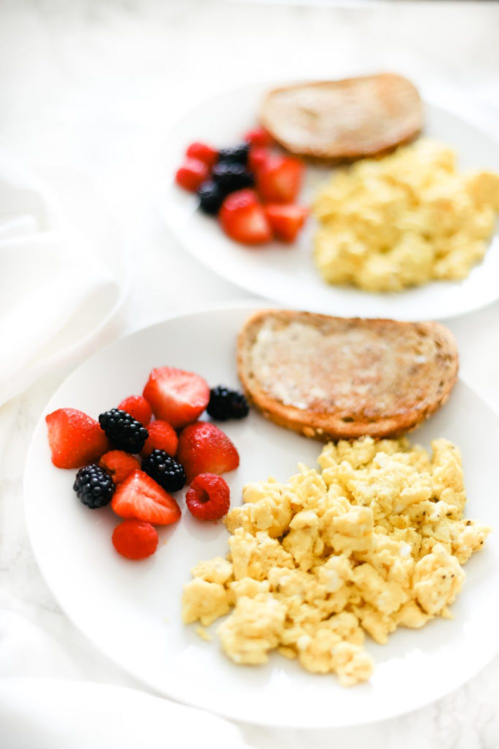 These perfect fluffy scrambled eggs make for a healthy, quick and easy breakfast every time. Naturally low in carbs, keto, and gluten-free. Breakfast | Brunch | Cooked Eggs | Keto Eggs | One Pan Breakfast | Creamy Eggs | Healthy | Weight Loss | How to Scramble Eggs | The Best Scrambled Egg Recipe | Family Friendly Recipe | Traditional Eggs | Egg Recipes |