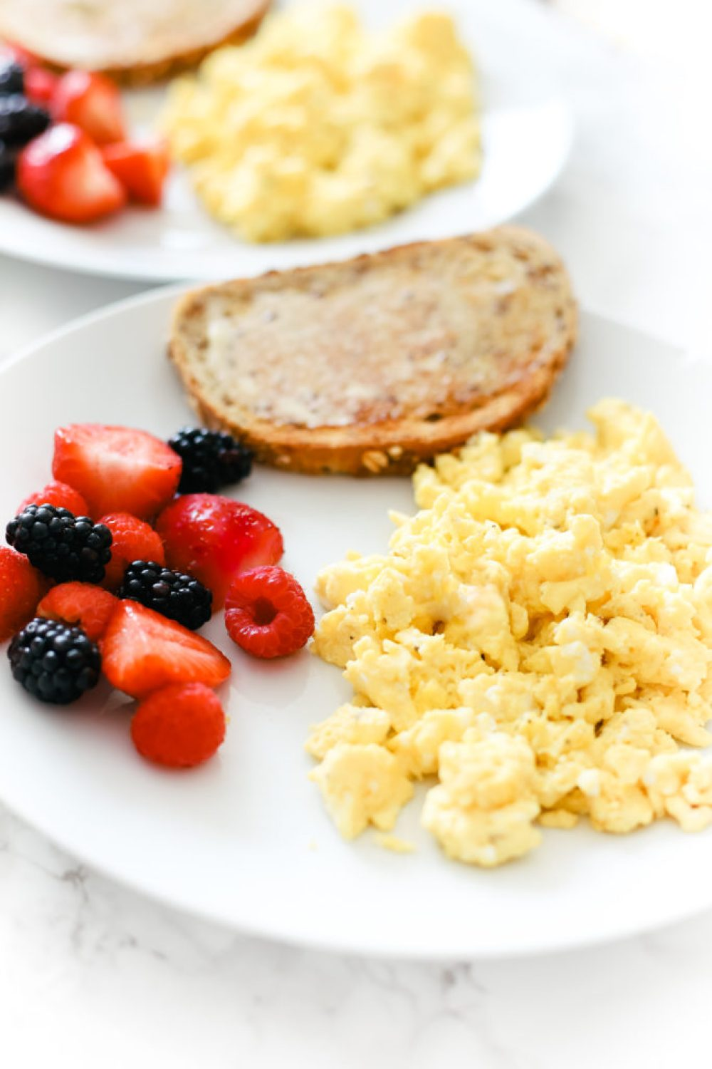 These perfect fluffy scrambled eggs make for a healthy, quick and easy breakfast every time. Naturally low in carbs, keto, and gluten-free. Breakfast | Brunch | Cooked Eggs | Keto Eggs | One Pan Breakfast | Creamy Eggs | Healthy | Weight Loss | How to Scramble Eggs | The Best Scrambled Egg Recipe | Family Friendly Recipe | Traditional Eggs | Egg Recipes | Toddler Food | Kid Friendly | Recipes for Kids |