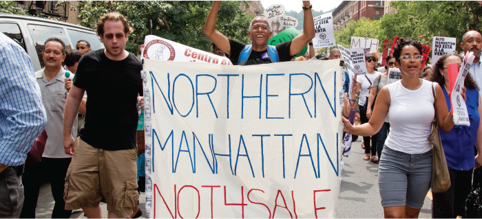 Northern Manhattan is Not For Sale at demonstration with banner