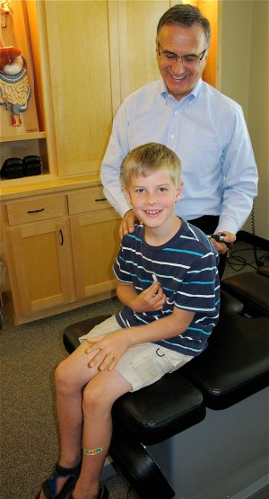 Dr. Patrick Giammarise works with a young patient David at the Digestion Relief Center in Chico.