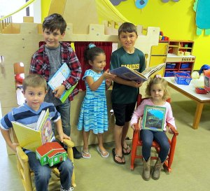 Young children love the colorful play area at Paradise Branch Library. Colton, Lowell, Peyton, Jayden and Chloe are all excited about the comfy child-sized chairs and great books!