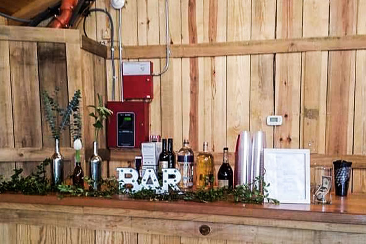 Bar setup on a wooden countertop at an event