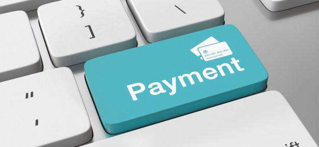 Payment key on keyboard representing available online payments.