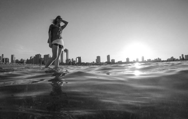 stunning travel portraits: just barely surfaced Go Pro in-water shot