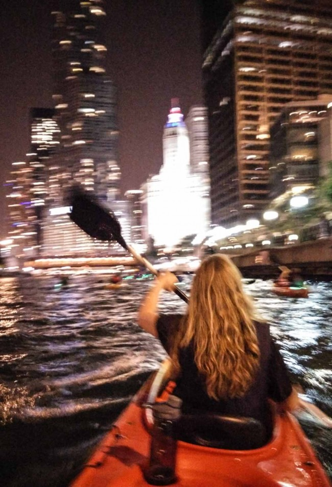 kayaking at night in downtown Chicago on the Chicago River