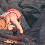 climbing the log ladder on a hike at Badlands National Park
