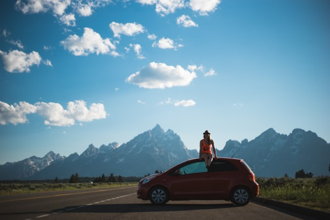 Sitting on the car in Grand Teton National Park
