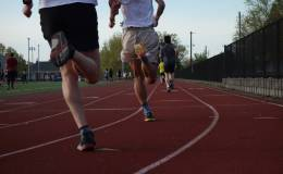 Legs and bodies fly onto the backstretch.