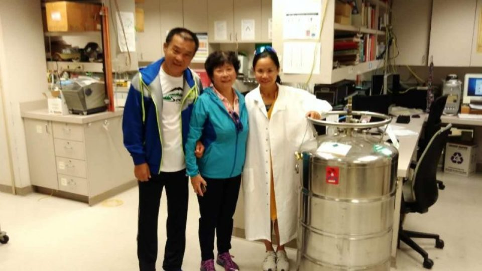 Proud parents with Sophia in her lab.