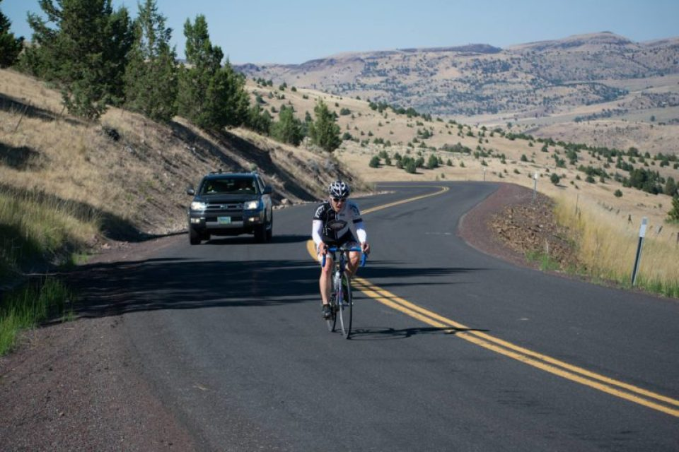 Sensity lenses at maximum darkness during an ascent of the Clarno grade in Central Oregon during Race Across Oregon 2018. Credit: Zach Goodin, .RAWyeti Images