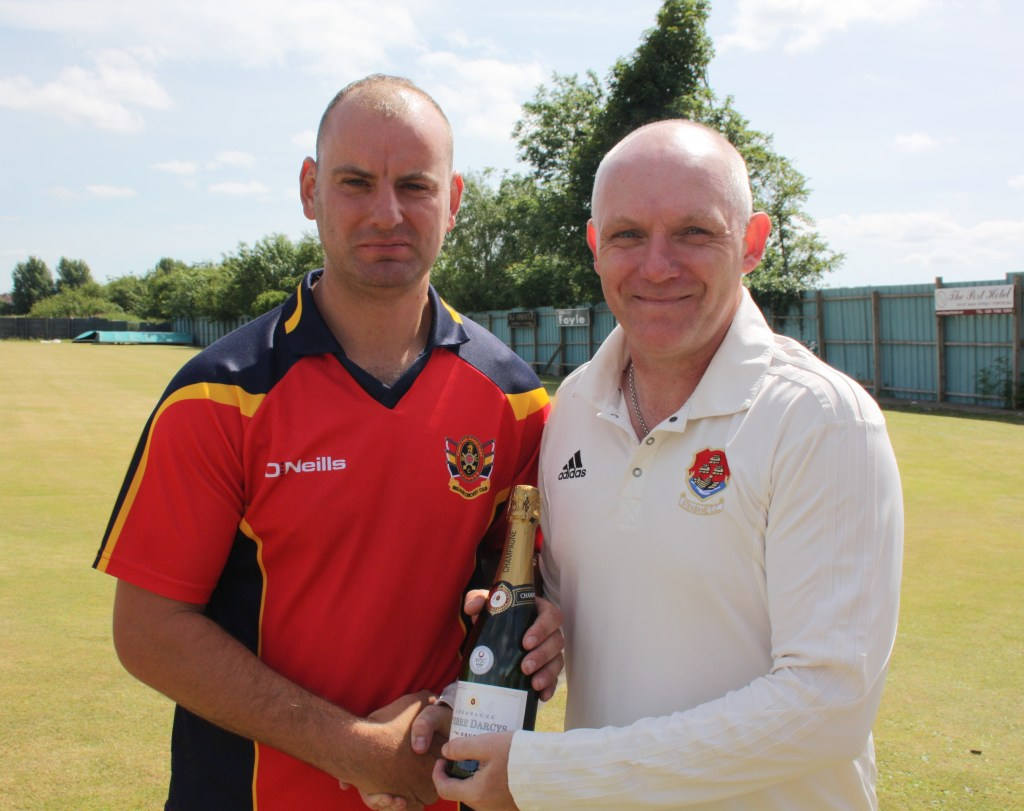 Peter Gillespie presents Andy Britton with his Player of the Round champagne