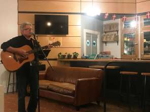 Local Danish musician, Flemming Behrend, playing for the jubilæumsfest at The Dane during Fredagscafe.