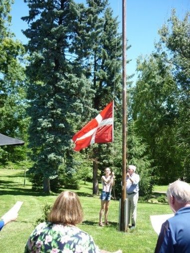 Claus Windelev, and his granddaughter, Sofia, raising the Danish flag. Photo by Kyle Dittmer