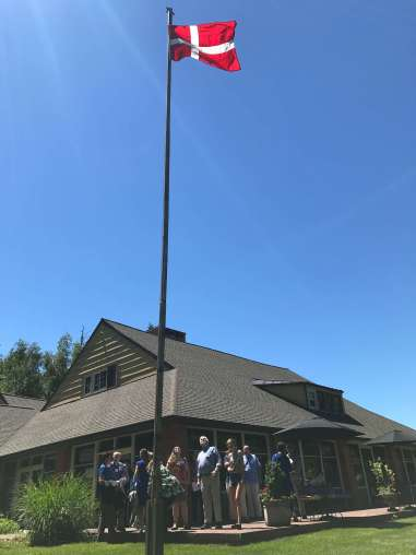 The flag-raising ceremony marked the start of the 39th annual Danish American Cultural Retreat