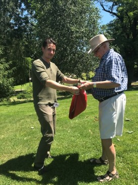 Rasmus Thøgersen, Executive Director a the Museum of Danish America, helps NWDA member and board member, Claus Windelev, with folding the Danish flag during the closing ceremony
