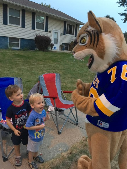Mascot with children from the neighborhood
