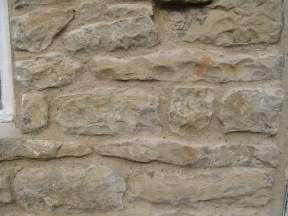 A good lime mortar mix and pointing method. The aggregate used in the mix has been exposed by brushing back the pointing to a recessed finish. Copyright NYMNPA.