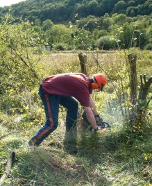 NPA Apprentice carrying out scrub control on wet grassland at Station Field 2008. Copyright NYMNPA.