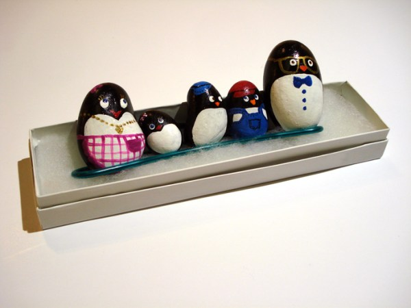 set of 5 stones depicting a family of penguins, each hand painted as mother, child or father by Ping Yan