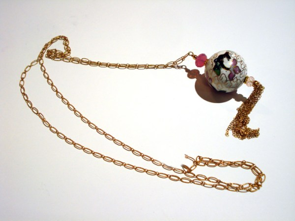 oriental styled pendant on gold chain necklace