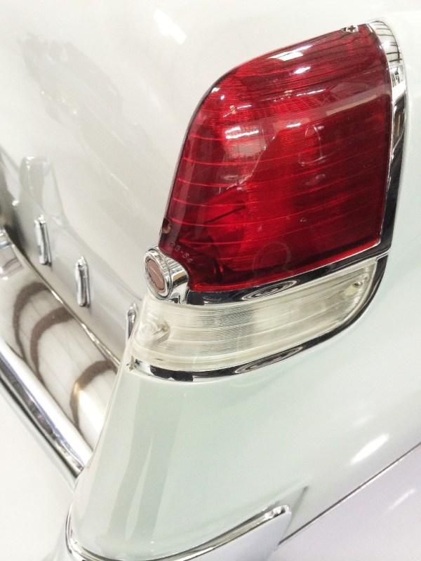 closeup photo of white stylized Cadillac tail light titled Fleetwood Tail 55 by Michael Rubin