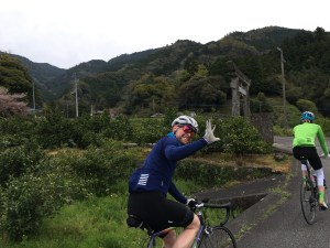 CYCLIST WAVING IN KYOTO