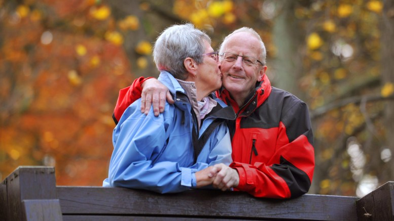 Love elderly couple walking in the park