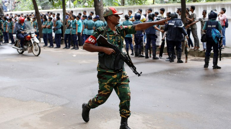 A security personnel reacts near the Holey Artisan restaurant after gunmen attacked the upscale cafe, in Dhaka