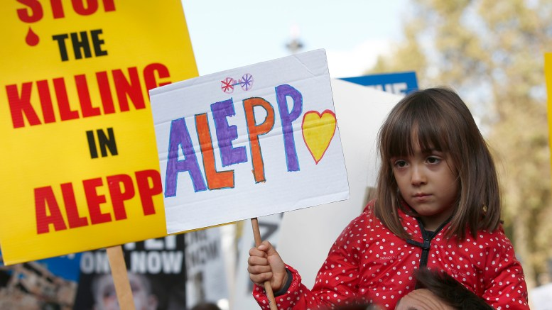 child holds a placard