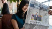 A woman reading China Daily