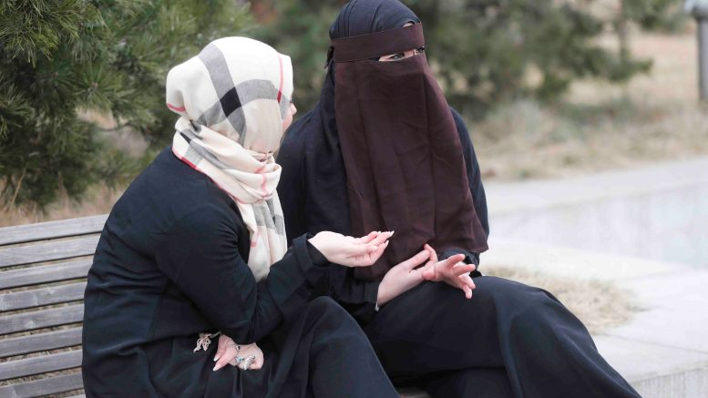 Women dressed in nikab and hijab