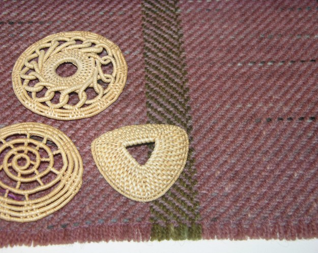 Oline Bredeli of Molde, Norway, taught weaving and working with teger, birch or spruce root, in 1982 and 1990. Canadian artist Karen Casselman's specialty is historical plant dyes. She taught dyeing at Vesterheim in 1997, 2002, and 2005. For this placemat, she used korkje, a Norwegian dye made from fermented lichens.