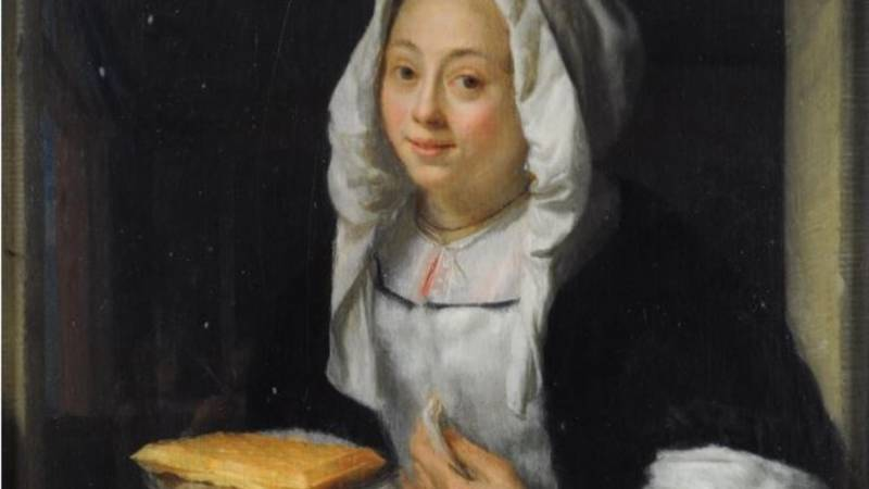 Young woman offering a wafer, by Godfried Schalcken