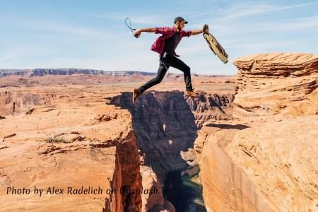 Man jumping a gorge