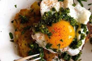 cauliflower fritter topped with an over-easy egg and green zhug